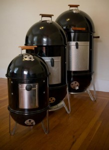 "From left to right, an original Weber 1880, Weber 18"" Smokey Mountain Cooker, Weber 22"" WSM"