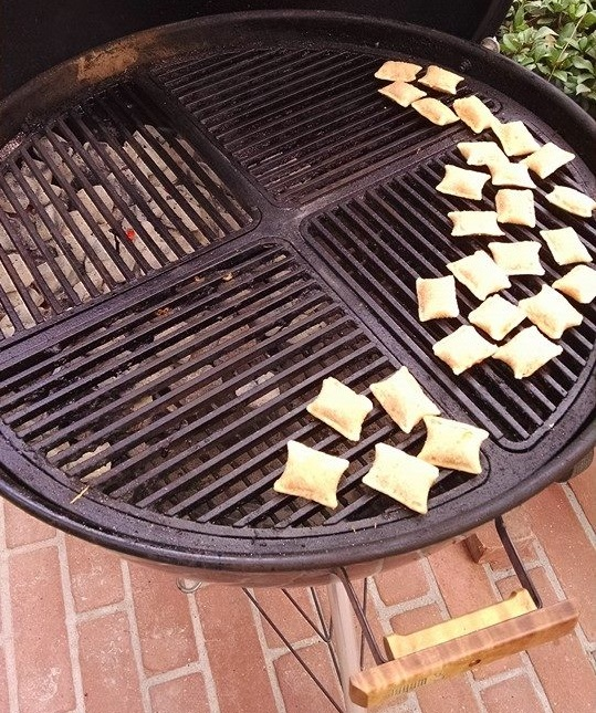 Grilling pizza rolls on a weber