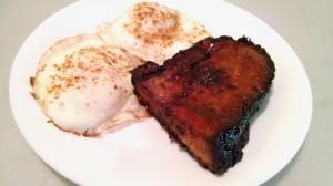 Unpulled pork steak and eggs
