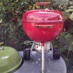 "The 18"" Midget on top of a Grass Green Weber Performer"