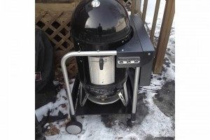 The  WSM has always been jealous of all the traveling the kettle next door does. Always wheeling around to and fro. Its time for the WSM to get mobile!